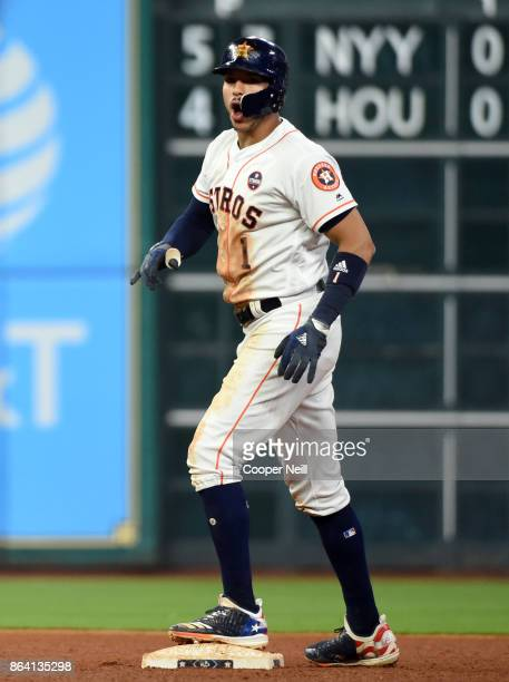 Carlos Correa of the Houston Astros reacts as he reaches second on a double in the eighth inning of Game 6 of the American League Championship Series...