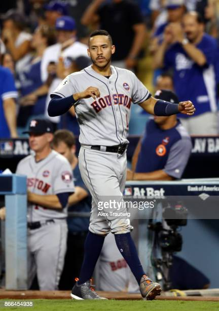 Carlos Correa of the Houston Astros reacts to a Marwin Gonzalez gametying home run in the ninth inning during Game 2 of the 2017 World Series against...
