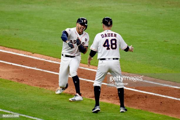 Carlos Correa of the Houston Astros reacts to hitting a tworun home run in the seventh inning during Game 5 of the 2017 World Series against the Los...