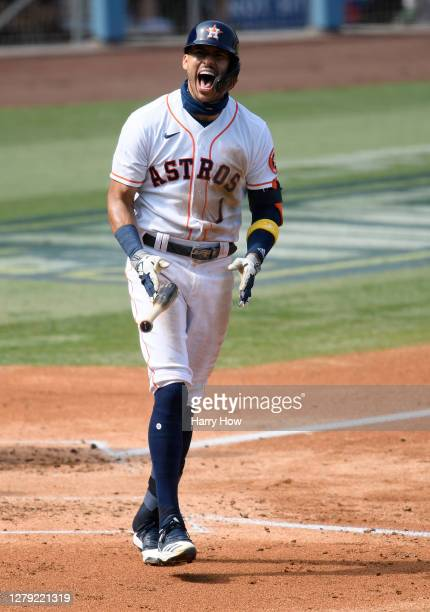 Carlos Correa of the Houston Astros rounds the bases after hitting a three run home run against the Oakland Athletics during the fourth inning in...