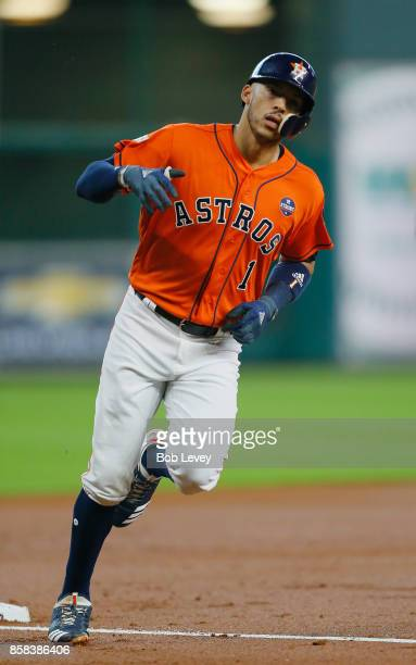 Carlos Correa of the Houston Astros runs the bases after hitting a two-run home run in the first inning against the Boston Red Sox during game two of...