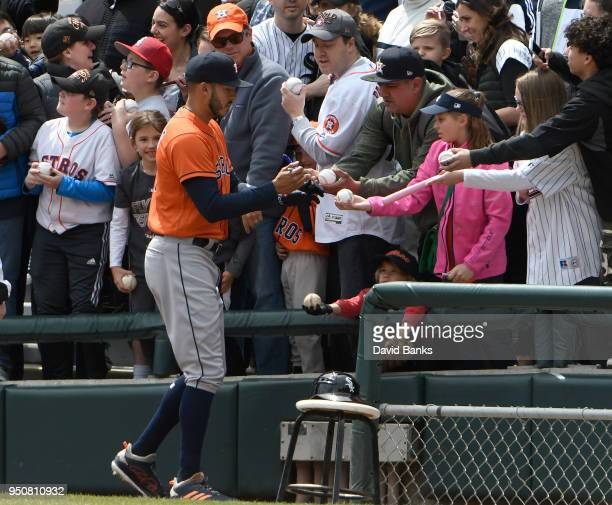 Carlos Correa of the Houston Astros signs autographs before the game against the Chicago White Sox on April 22 2018 at Guaranteed Rate Field in...
