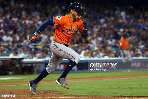 Carlos Correa of the Houston Astros singles in the sixth inning during Game 7 of the 2017 World Series against the Los Angeles Dodgers at Dodger...