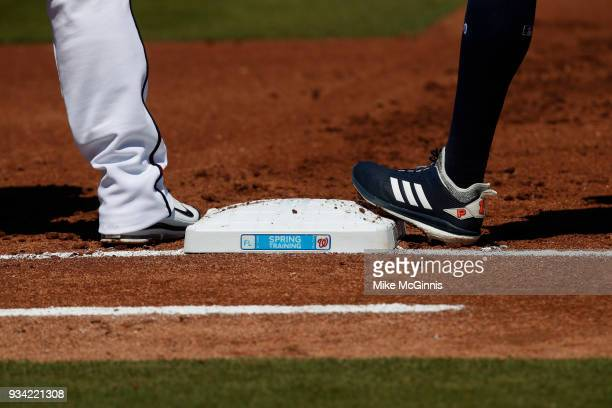 Carlos Correa of the Houston Astros stands at first base in his Adidas cleats during a spring training game against the Washington Nationals at...