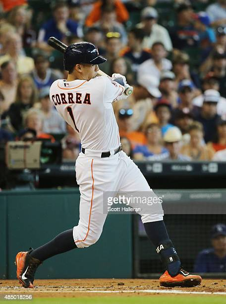 Carlos Correa of the Houston Astros swings at a pitch in the first inning during their game against the Los Angeles Dodgers at Minute Maid Park on...