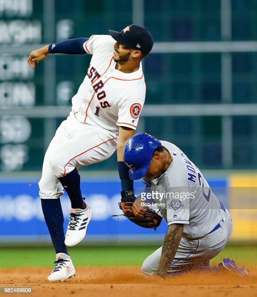 Carlos Correa of the Houston Astros tags out Adalberto Mondesi of the Kansas City Royals trying to steal second base in the ninth inning at Minute...