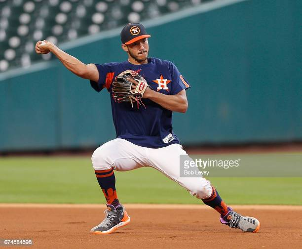 Carlos Correa of the Houston Astros takes infield during batting practice at Minute Maid Park on April 28 2017 in Houston Texas