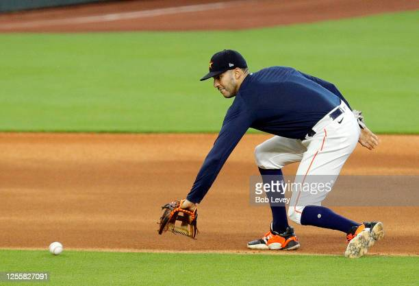 Carlos Correa of the Houston Astros takes infield practice during Summer Workouts at Minute Maid Park on July 12, 2020 in Houston, Texas.