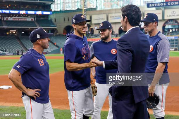 Carlos Correa of the Houston Astros talks with Christian Yelich of the Milwaukee Brewers during batting practice prior to Game Two of the 2019 World...