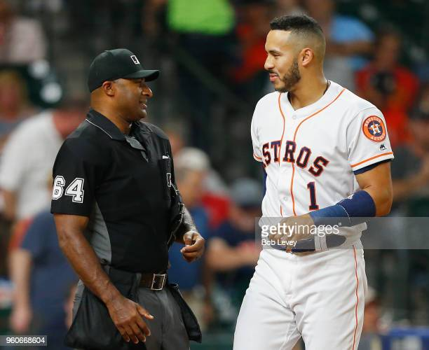 Carlos Correa of the Houston Astros talks with home plate umpire Alan Porter after he called out on strikes looking in the third inning against the...