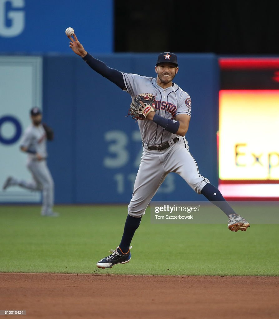 Carlos Correa #1 of the Houston Astros throws out a baserunner in the fourth inning during MLB game action against the Toronto Blue Jays at Rogers Centre on July 6, 2017 in Toronto, Canada.