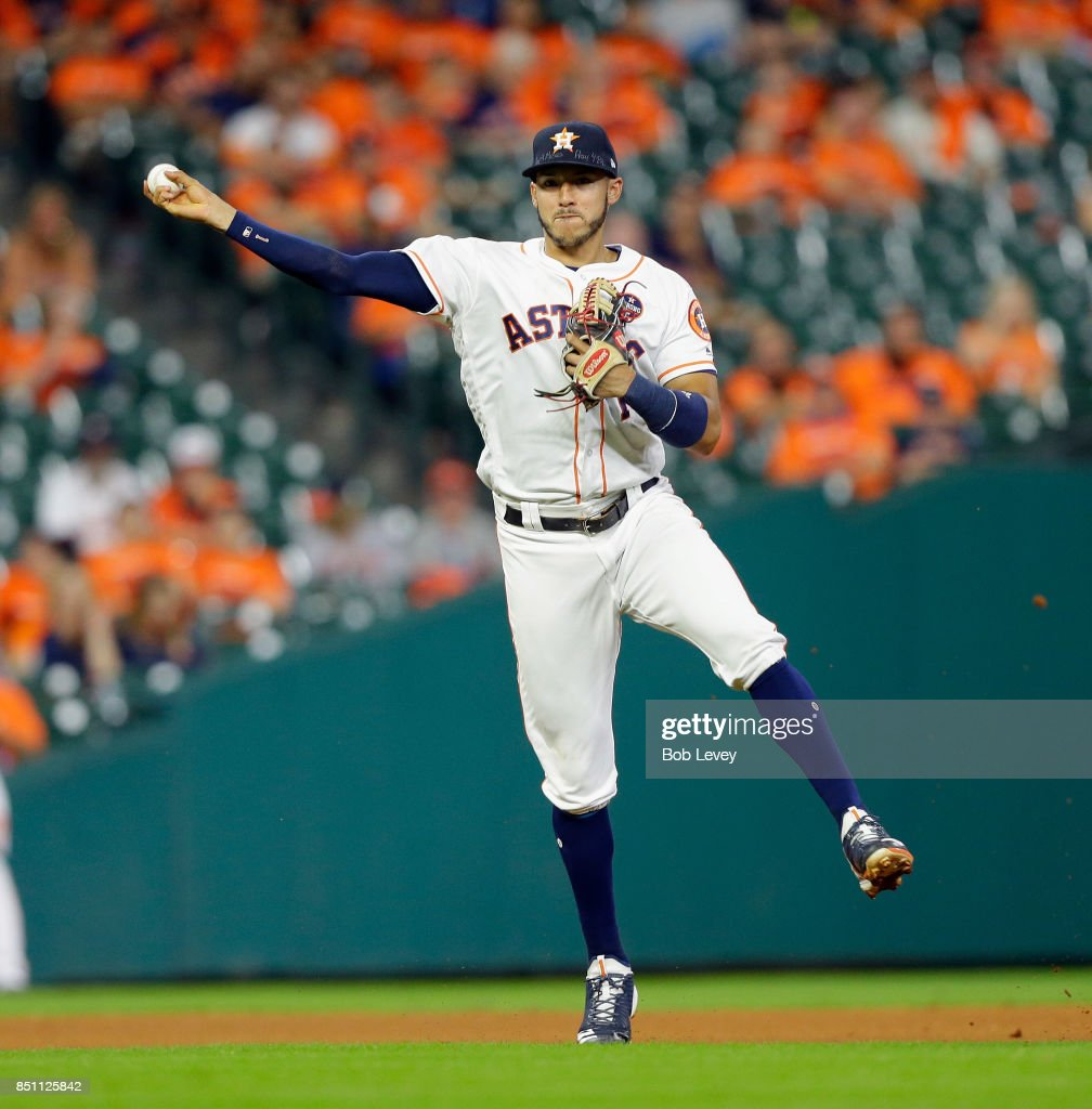 Carlos Correa #1 of the Houston Astros throws out Avisail Garcia #26 of the Chicago White Sox in the eighth inning at Minute Maid Park on September 21, 2017 in Houston, Texas.