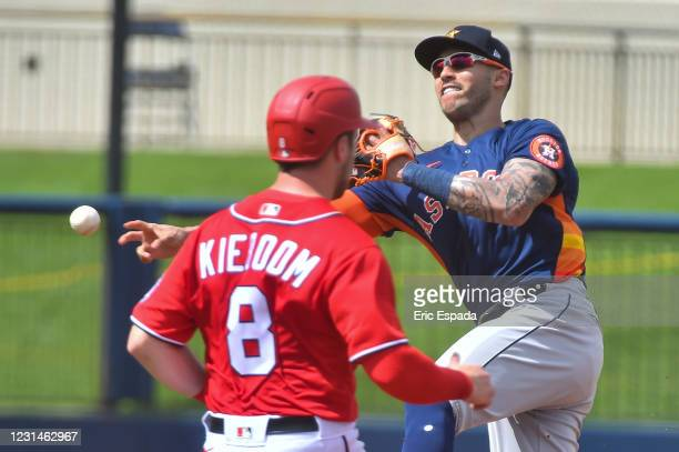 Carlos Correa of the Houston Astros throws towards first base during the second inning of the Spring Training game against the Washington Nationals...