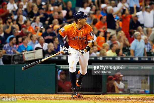 Carlos Correa of the Houston Astros watches his solo home run in the fifth inning during their game against the Arizona Diamondbacks at Minute Maid...