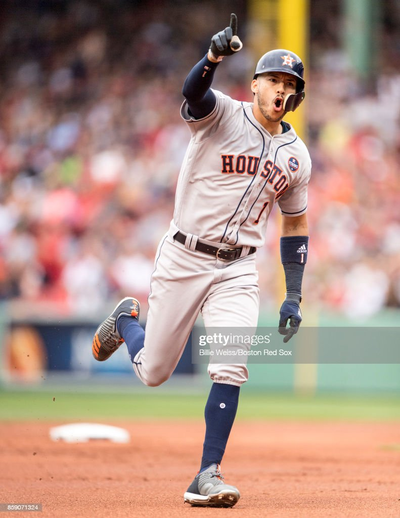 Carlos Correa #1of the Houston Astros reacts after hitting a two run home run during the first inning of game three of the American League Division Series against the Boston Red Sox on October 8, 2017 at Fenway Park in Boston, Massachusetts.
