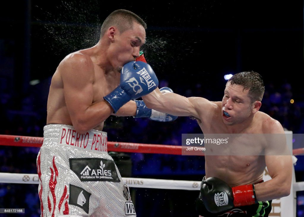 Carlos Cuadras of Mexico lands a right hand to the head of Juan Francisco Estrada of Mexico at StubHub Center on September 9, 2017 in Carson, California.