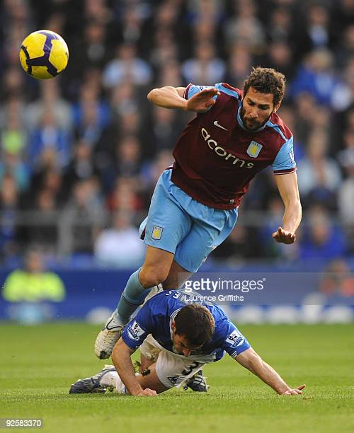 Carlos Cuellar of Aston Villa battles with Leighton Baines of Everton during the Barclays Premier League match between Everton and Aston Villa at...