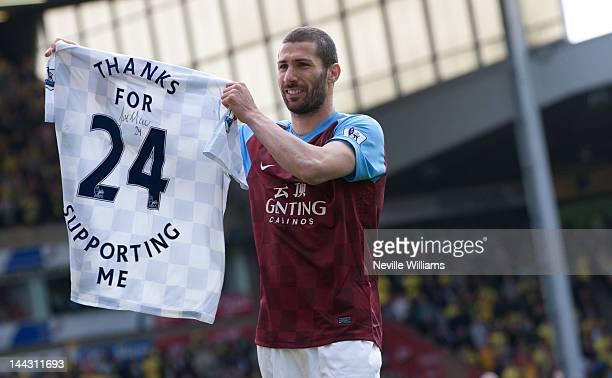 Carlos Cuellar of Aston Villa waves goodbye to the Aston Villa fans after the Barclays Premier League match between Norwich City and Aston Villa at...