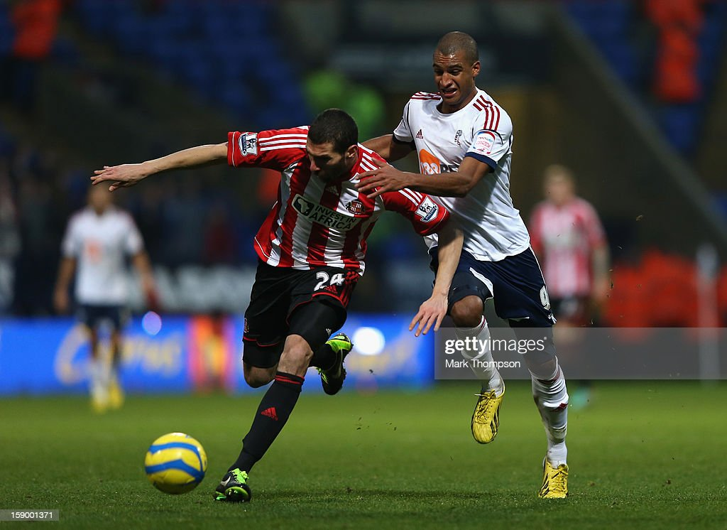 Carlos Cuellar of Sunderland battles fo rthe ball with David N'Gog of Bolton Wanderers during the FA Cup with Budweiser Third Round match between Bolton Wanderers and Sunderland at the Reebok Stadium on January 5, 2013 in Bolton, England.