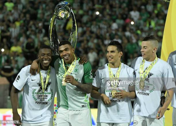 Carlos Cuesta Elkin Blanco Diego Arias and Mateus Andres Uribe of Nacional celebrate with their medals as champions of the Liga Aguila I 2017 after...