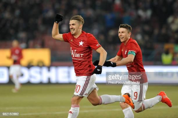 Carlos Daniel Lopez Huesca Carlitos and Rafal Boguski celebrates scoring the goal with team mates during Lotto Ekstraklasa match between Wisla Krakow...