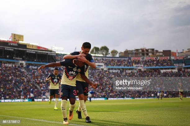 Carlos Darwin Quintero and Oribe Peralta of America celebrate the first goal of their team during the 13th round match between Cruz Azul and America...