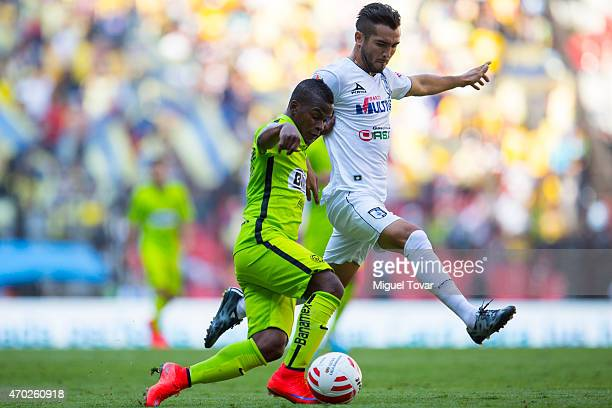 Carlos Darwin Quintero of America fights for the ball with Mario Osuna of Queretaro during a match between America and Queretaro as part of 14th...