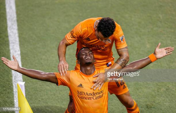 Carlos Darwin Quintero of Houston Dynamo is congratulated by Niko Hansen after a goal in the first half against the Minnesota United at BBVA Compass...