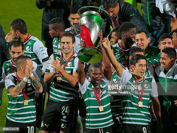 Carlos Darwin Quintero of Santos celebrates with the trophy after winning a Final match between Santos Laguna and Puebla as part of Copa MX Apertura...