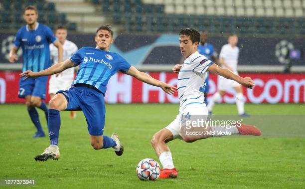 Carlos De Pena of Kyiv battles for the ball with Alessio CastroMontes of KAA Gent and scores the 12 goal during the UEFA Champions League PlayOff...