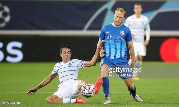 Carlos De Pena of Kyiv battles for the ball with Roman Bezus of KAA Gent during the UEFA Champions League PlayOff first leg match between KAA Gent...