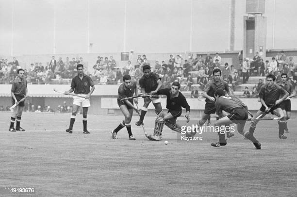 Carlos del Coso the goalkeeper for Spain blocks the attack of Pakistan during their Men's Olympic Field Hockey Tournament match on 21st October 1964...