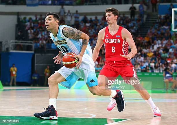 Carlos Delfino of Argentina moves the ball against Mario Hezonja of Croatia during a preliminary round basketball game between Croatia and Argentina...