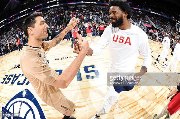 Carlos Delfino of Argentina shakes hands with DeAndre Jordan of the USA Basketball Men's National Team before the game on July 22 2016 at TMobile...