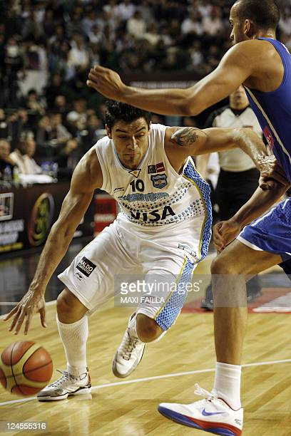 Carlos Delfino of Argentina, tries to dribble past Ricardo Sanchez, of Puerto Rico, during the 2011 FIBA Americas Championship qualifying round...