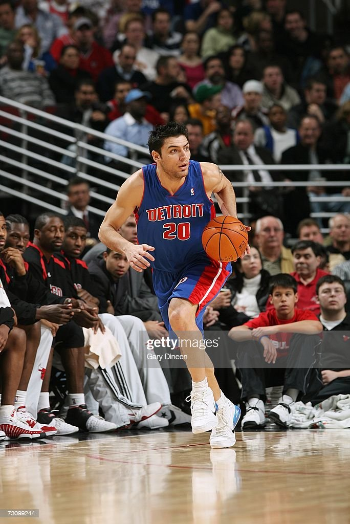 Carlos Delfino #20 of the Detroit Pistons moves the ball against the Chicago Bulls during the game at the United Center on January 6, 2007 in Chicago, Illinois. The Bulls won 106-89.