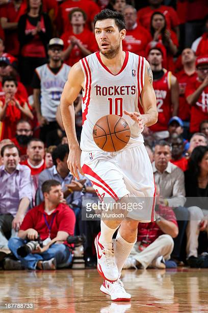 Carlos Delfino of the Houston Rockets advances the ball against the Oklahoma City Thunder in Game Four of the Western Conference Quarterfinals during...