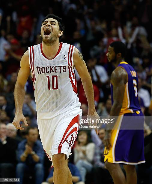 Carlos Delfino of the Houston Rockets celebrates a basket against the Los Angeles Lakers at Toyota Center on January 8 2013 in Houston Texas NOTE TO...