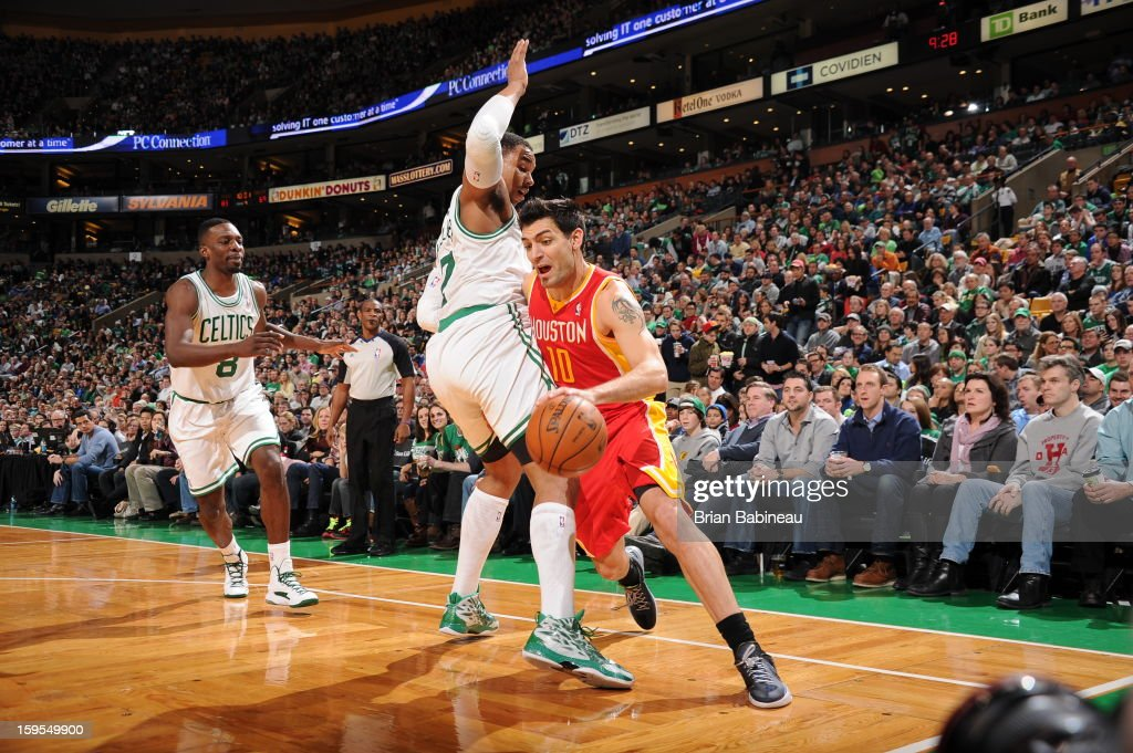 Carlos Delfino #10 of the Houston Rockets drives to the basket against Jared Sullinger #7 of the Boston Celtics on January 11, 2013 at the TD Garden in Boston, Massachusetts.