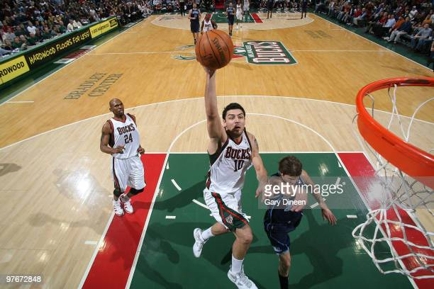 Carlos Delfino of the Milwaukee Bucks shoots a layup against Kyle Korver of the Utah Jazz on March 12 2010 at the Bradley Center in Milwaukee...
