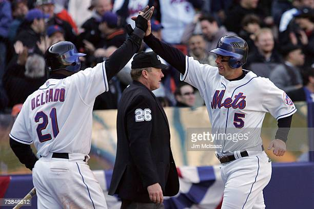 Carlos Delgado and David Wright of the New York Mets celebrate after scoring on a hit by Moises Alou in the eighth inning against the Philadelphia...