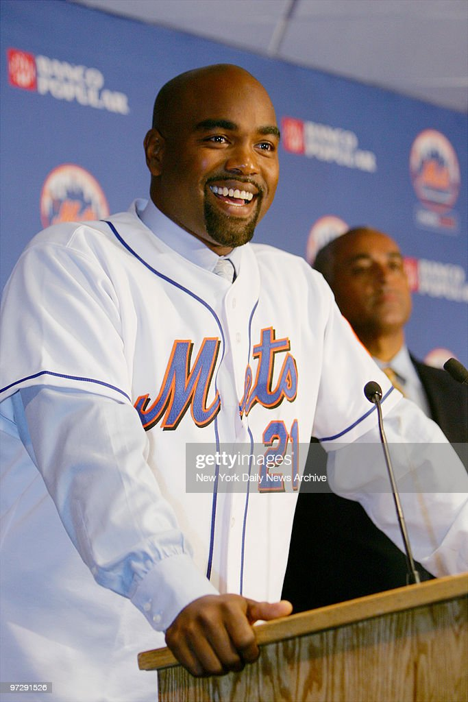 Carlos Delgado is all smiles during a news conference at