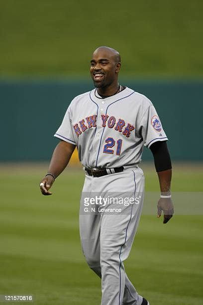Carlos Delgado of the Mets has a laugh prior to action between the New York Mets and the St. Louis Cardinals at Busch Stadium in St. Louis, Missouri...