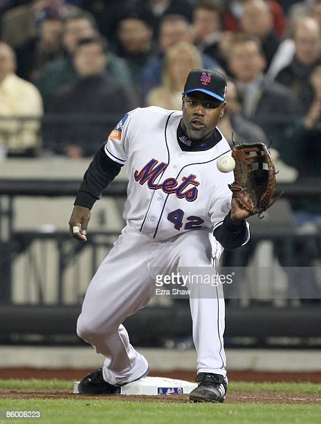Carlos Delgado of the New York Mets catches a ball at first base during their game against the San Diego Padres on April 15 2009 at Citi Field in the...
