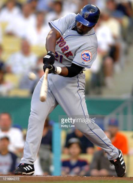Carlos Delgado of the New York Mets hits a first-inning home run during 4-1 victory over the Los Angeles Dodgers at Dodger Stadium in Los Angeles,...