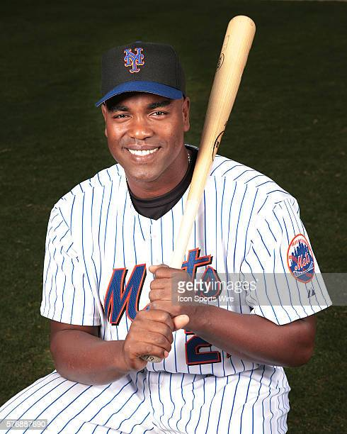Carlos Delgado of the New York Mets pose for an inpromptu photo shoot during Spring Training in Florida