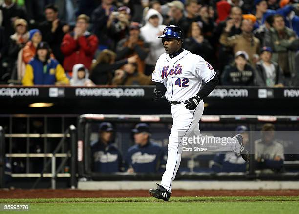 Carlos Delgado of the New York Mets rounds the bases after he hit a solo home run in the eighth inning of their game against the San Diego Padres on...
