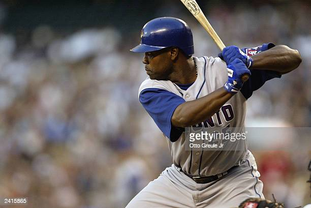 Carlos Delgado of the Toronto Blue Jays bats against the Seattle Mariners during the game on August 13 2003 at Safeco Field in Seattle Washington The...