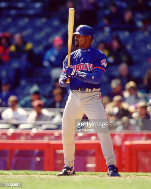 Carlos Delgado of the Toronto Blue Jays bats during an MLB game against the Milwaukee Brewers at County Stadium in Milwaukee, Wisconsin during the...