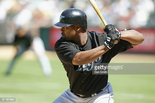 Carlos Delgado of the Toronto Blue Jays bats during the MLB game against the Oakland A's at the Network Associates Coliseum on July 20 2004 The A's...